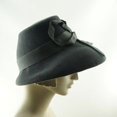 This is a gray cloche hat handmade by me. It is reserved.    I hand blocked gray fur felt on a vintage hat block to make the crown shape. The