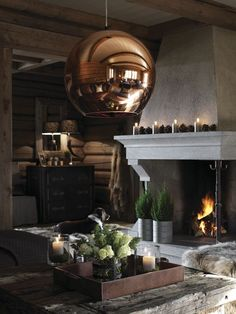 Modern rustic design, wood furnishings, rustic elements, stone fireplace, wood wall treatment, copper pendant lighting.