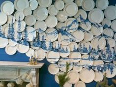 painted plates as canvas in a art wall installation display; Upcycle, Recycle, Salvage, diy, thrift, flea, repurpose! For vintage ideas and goods shop at Estate ReSale & ReDesign, Bonita Springs, FL by Hercio Dias