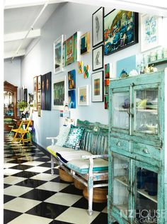 The high-ceilinged hallway was always going to be a gallery, says Pien, who has built her eclectic collection of New Zealand art over many years. - See more at: http://nzhouseandgarden.co.nz/feathering-her-nest/#sthash.YbQPwYaG.dpuf