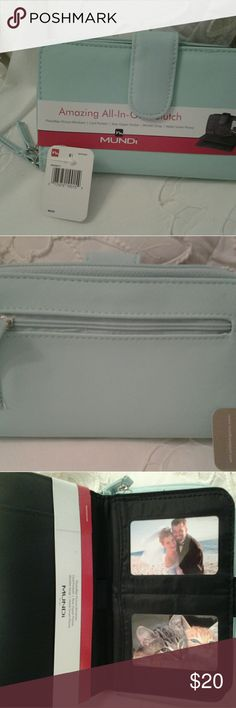 """MUNDI AMAZING ALL-IN-ONE CLUTCH BEAUTIFUL AQUA I HAVE A NEW BEAUTIFUL SPRING COLOR """" AQUA BLUE/GREEN""""  ALL-IN-ONE CLUTCH   FOR SALE.  IT HAS 10 CARD SLOTS,  TWO PHOTO FLIP WINDOWS   HOLDS SMART PHONE  REAR ZIPPER  POCKET   WRISTLET STRAP  ONE OPEN WINDOW FOR DRIVERS LICENSE   HAS ZIP AROUND ON ONE SIDE FOR SECURITY FOR MONEY .  THIS IS REALLY A NICE WALLET, ANY QUESTIONS, PLEASE ASK.  THANKS MUNDI  Bags Clutches & Wristlets"""