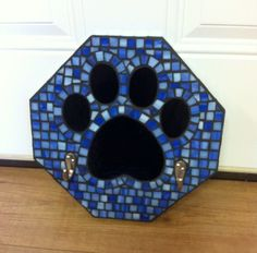 Mosaic paw print leash holder for our fur friends. By Cathy Garner