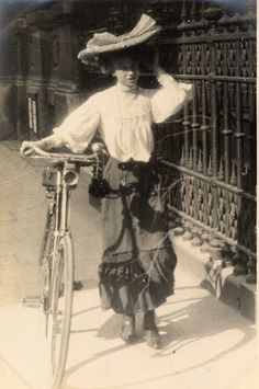 A cyclist struggles with an enormous hat.  (Street style 1906: Edward Linley Sambourne)