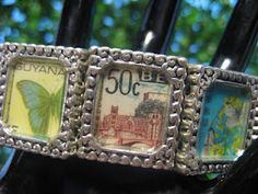 Butterfly Kisses.  Stretch Bracelet made with 7 vintage postage stamps from around the world.