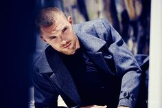Ed Skrein kneels down in a Theory gray wool coat. Theory Coat, Price Upon… The Sweeney, Photo Ed, Honey And Clover, Slim Fit Pants, Cropped Trousers, Male Beauty, Wool Coat, We The People, Hot Guys