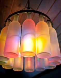 Outside Patio frosted glass wine bottle chandelier candles colored lights ~ cool!