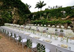 love the tight centerpieces wrapped like bouquets  & the leaves on the chairs. David Tutera