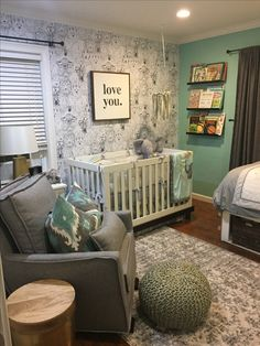 Boy Nursery, chasing paper wallpaper- wild thing, house of belonging- love you sign, land of nod grey glider, overstock- grey rug and poof, target- raw wood and brass side table, target l- brass lamp, IKEA- black book shelves, teal paint, target- grey curtains