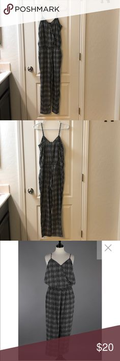 Express Casual Jumpsuit Stylish Express Casual Jumpsuit. Like new, worn once. Has a nice fit to it. Black and white detail. Express Pants Jumpsuits & Rompers