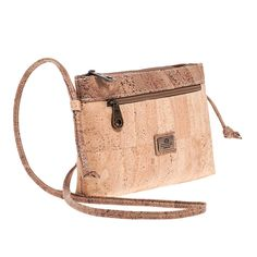 Vegan Cork Crossbody Bag with a front zipped pocket. Eco-friendly, durable and made in Portugal with Portuguese cork. Montado – Cork Fashion.