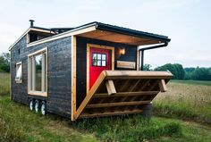 tiny house offers reclaimed style and drawbridge deck The off-grid tiny house on wheels is now available to order.The off-grid tiny house on wheels is now available to order. Tiny Mobile House, Off Grid Tiny House, Best Tiny House, Modern Tiny House, Tiny House Living, Tiny House Plans, Tiny House On Wheels, Tiny House Design, Mobile Home