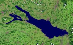 """Satellite Image of Lake Constance, [German: Bodensee] -- Lake Constance  is a lake on the Rhine at the northern foot of the Alps; consists of three bodies of water: the Obersee (""""upper lake""""), the Untersee (""""lower lake""""), and a connecting stretch called the See-rhein. The lake is situated in Germany, Switzerland and Austria near the Alps.The fresh-water lake sits at 395 m (1,296 ft) above sea level and is Central Europe's third largest, after Lake Balaton and Lake Geneva."""