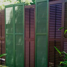 Fence made out of recycled shutters. Privacy screen at edge of porch or patio.