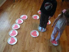 Write Letters on hearts...  Letter walk each person moves from letter to letter (walk, skip, jump) until the music stops. Then they tell what letter they are on and/or what sound it makes.