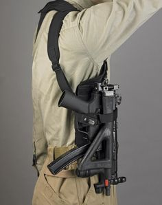 DeSantis DSD Tactical Subgun Rig A shoulder holster for sub-machine guns such as the and UZI. The gun pictured is an with the 30 round magazine. The full-size magazine makes it difficult to. Revolver, Pistol Holster, Leather Holster, Holsters, Weapons Guns, Guns And Ammo, Airsoft Guns, Ak47, Protection Rapprochée