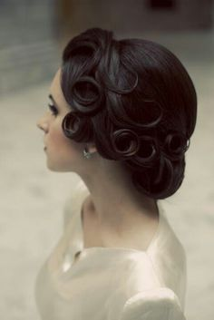 1940s hair for the curls on the side. I love 1940s hair, its so classy and elegant.