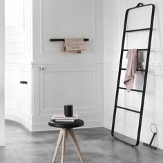 Towel Ladder by Menu is an informal and flexible piece of furniture made for storing towels and accessories in the bathroom - clothes in the bedroom - or scarves and coats in the hallway. It's easy to move around the house and the leather strap at the top almost makes it look like an oversize suitcase, that you can lift and take anywhere.
