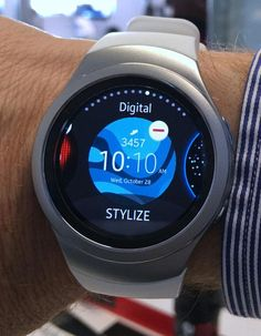 You select from the available Gear S2 watch face options by pressing down in the screen