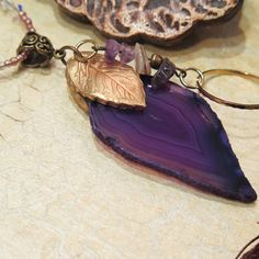 Beautiful purple agate necklace made of agate slice and polymer clay leaf decorated with copper metallic powder and amethyst beads. DANA BROSH special