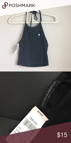 RARE Alien Emoji Patch on Black Sachi Halter Not sold anymore!!! One of Brandy Melville's Trademarks. A chic trade on a classic closet staple. Adjustable tie up cropped halter. Purchased from Pacsun, New with tags. Brandy Melville Tops Tank Tops