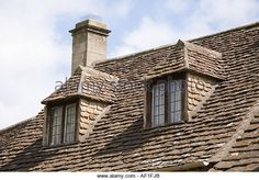 dormer-windows-in-a-cotswold-stone-roof-on-a-cottage-at-castle-combe-af1fjb.jpg 640×446 pixels