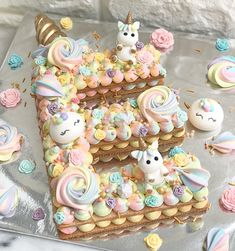 """Unicorn Cookies Cake customized in alphabet """"E"""" // For all orders and enquiries please drop us a whatsapp at +6588699777 #euphoriquesg…"""