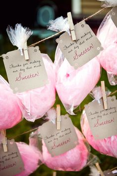 Send guests home with a sweet and nostalgic treat when you string a clothesline with bags of delicious cotton candy. Photo courtesy of Tim Robison Creative