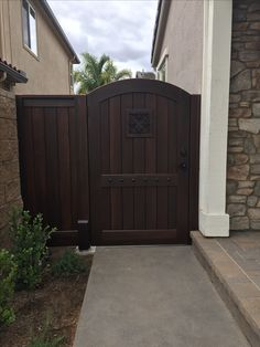 Custom Wood Gate by Garden Passages - Large Arched Top Side Gate with Decorative Clavos and Decorative Iron Grill Backyard Gates, Backyard Hammock, Backyard Landscaping, Backyard Barn, Backyard Ideas, Garden Ideas, Fence Gate Design, Modern Fence Design, Side Gates