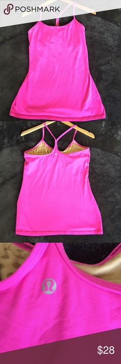 Lululemon Pink racer back tank Gently loved Lululemon racer back Pink tank top. Super soft and stretch. Still lots of wear left in this beautiful tank! 💞 no size tag but is the same size as a Nike medium. lululemon athletica Tops Tank Tops