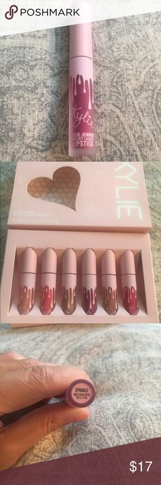 "AUTH KYLIE BDAY ""SPRINKLE""  MINI VELVET LIPSTICK No trades! AUTH KYLIE BIRTHDAY COLLECTION ""SPRINKLE""  MINI VELVET LIPSTICK - a VIBRANT PLUM SHADE! NIP! This is for (1) *single* AUTHENTIC KYLIE BIRTHDAY MINI VELVET LIPSTICK in shade ""SPRINKLE"""". Each Velvet travel size lippie is 0.02 fl oz./oz. liq / 0.70 ml. THIS AUCTION IS FOR THE MINI VELVET LIPSTICK in shade ""SPRINKLE"" ONLY. Each Velvet Liquid Lipstick Mini Kit contains 6 shades which can be found in my other listings. Kylie Cosmetics…"