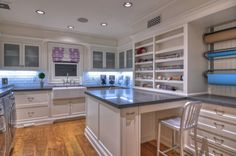 Complete inspiration pic for a combo craft/laundry room in the basement!  Very little natural light, but in keeping lots of white finishes and strategic lighting, this could work