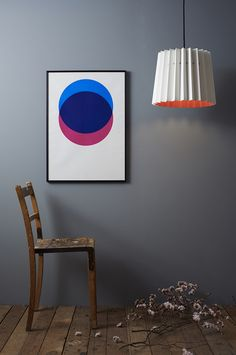 CIRCLES – BLUE AND PINK  HAND-PULLED SCREEN PRINT    Hand screen printed on to beautifully textured paper made in England.    Colours are bright pink and bright blue with the two elements overlapping to produce a deep indigo.    Available unframed or framed in an aluminum matt black finish. 50cm x 70cm  Unframed: £35, Framed: £80