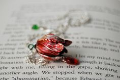 Here is a gorgeous Tulip necklace inspired by the book cover of New Moon from the Twilight saga.