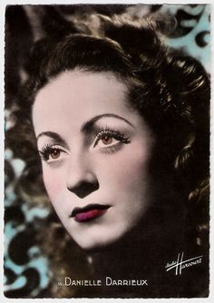 https://flic.kr/p/Jo4H2G | Danielle Darrieux | French postcard by S.E.R.P., Paris, no. 15. Photo: Studio Harcourt.  French actress and singer Danielle Darrieux (1917) is an enduringly beautiful, international leading lady. From her film debut in 1931 on she progressed from playing pouty teens to worldy sophisticates. In the early 1950s she starred in three classic films by Max Ophüls, and she played the mother of Catherine Deneuve in five films!   For more postcards, a bio and clips check…
