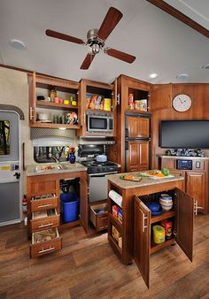 A stocked kitchen in the 2015 Forest River Wildcat 344QB