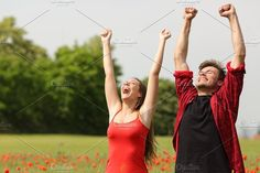 Euphoric couple raising arms in the country.jpg. People Photos