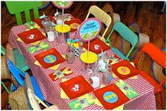Loving Mums: Farmyard/ Barnyard Party--checkered tablecloth + red & yellow and bits of green tableware. Loving the little milk jugs!