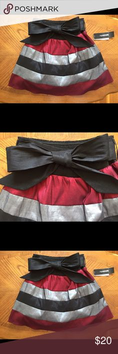 Striped Holiday Skirt With Bow Detail Gorgeous red, black, and silver skirt with oversized bow detail. Pair it with black tights and a black 3/4 sleeve top or body suit for a chic, polished look. Perfect for all those upcoming holiday parties!🎉 NWT, never worn. My Michelle Skirts