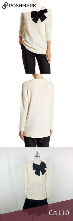 """Kate Spade Cream with Black Bow Wool Tunic Sweater This 100% wool tunic sweater in size XS, has a crew neck, long sleeves, front black fabric bow detail and is approx. 27"""" length. This is a great sweater to wear with leggings or skinny jeans. In excellent, like new condition. Kate Spade Sweaters Crew & Scoop Necks Owl Sweater, Purple Sweater, Tunic Sweater, Red Sequin Dress, Orange Sweaters, Slip Skirts, Color Block Sweater, Black Fabric, Kate Spade"""