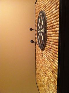 Perfect for the Mancave! Wine corks behind the dart board to save your wall!