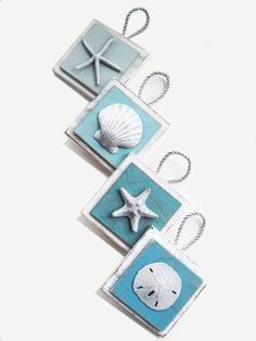 What about these ornaments? Terri Ornaments Set of 4 Silver and Turquoise Coastal Christmas Coastal Christmas Decor, Nautical Christmas, Tropical Christmas, Beach Christmas, Christmas Crafts, Christmas Ornaments, Xmas, Christmas Wood, Scandinavian Christmas