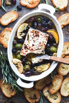 Baked Feta with Olives, Lemon and Rosemary ~ an easy baked cheese appetizer that shows off the spect. Baked Feta with Olives, Lemon and Rosemary ~ an easy baked cheese appetizer that shows off the spect. Cheese Appetizers, Appetizers For Party, Appetizer Recipes, Party Snacks, Tapas Recipes, Dinner Recipes, Feta Cheese Recipes, Greek Appetizers, Pepperoni Recipes