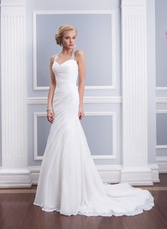 Lillian West lillian west style 6310 Chiffon fit and flare features asymmetrical pleating and a beaded halter  neckline with a criss-cross keyhole back. Gown has chapel length train  and chiffon buttons cover the zipper.