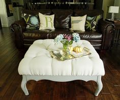 turn an old coffee table into a beautiful tufted ottoman. I am so gonna try this...glad my husband refuses to throw out a really nice coffee table that the glass from it got broken and the table has been unusable for a year or two!