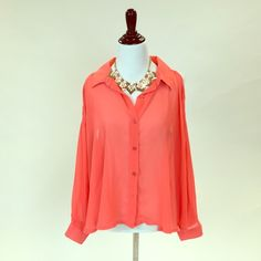 Coral sheer top New with tags. It has a wide fit and 4 slits in the back of the shirt. New with tags! Cotton On Tops
