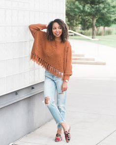 Distressed jeans and fringe sweaters