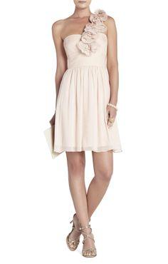 Ivory dress with flower shoulder detail.