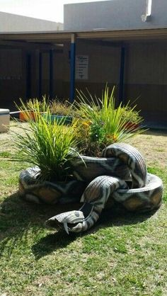 Tire-Planter painted and configured as a giant snake!