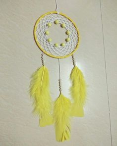 Yellow Beads Dreamcatcher feathers web design wall decor.  For order contact on 8268230251.