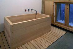 Rammed earth tub; BCHO Architects